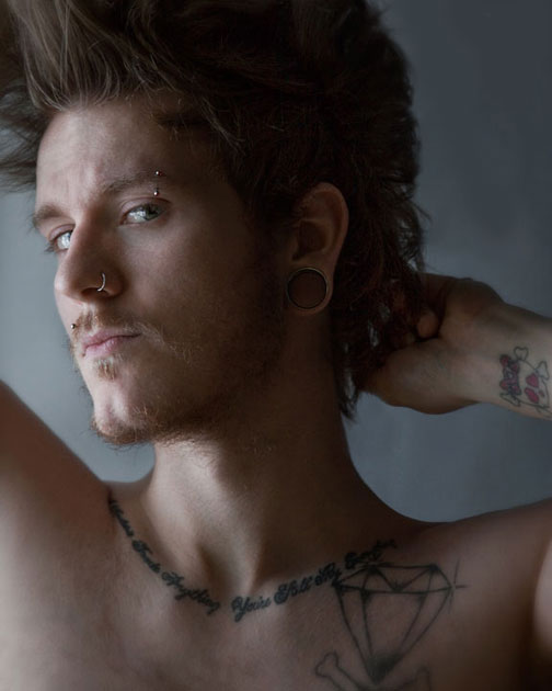 Portrait of Male with tattoos and piercings
