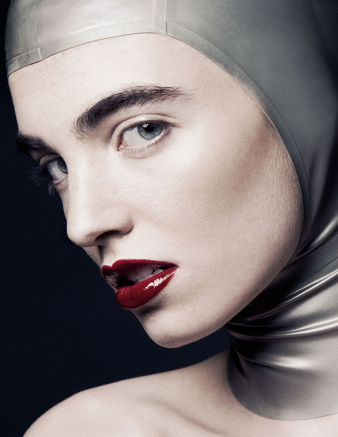 Girl in latex headpiece with a red lip