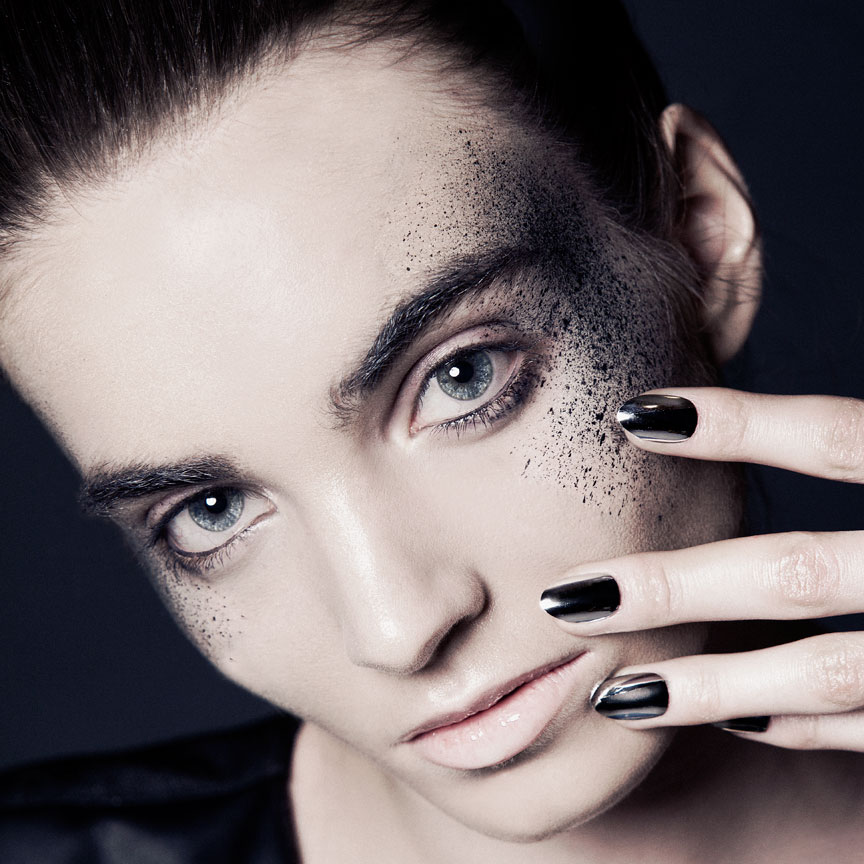 dark beauty photography with chrome nails