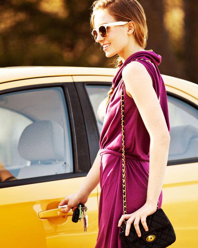 Girl getting into yellow car