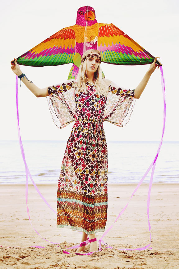 boho girl on beach with kite