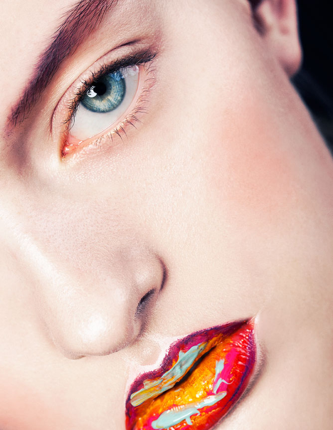 Colorful macro beauty with a focus on multicolored lipstick