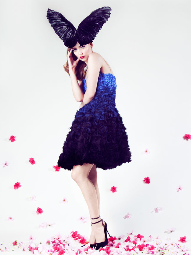 model in ombre floral dress with wing hat