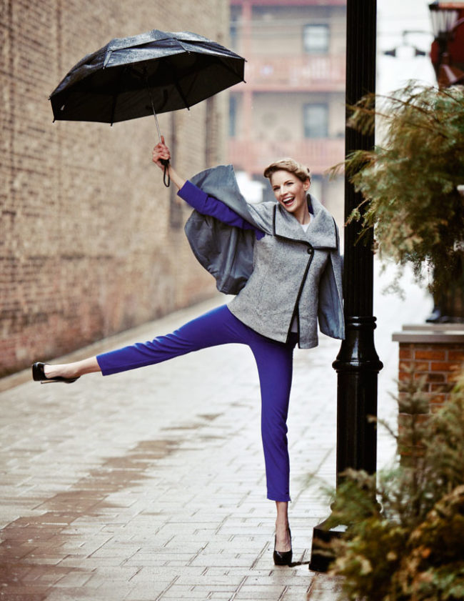 Girl smiling in the rain